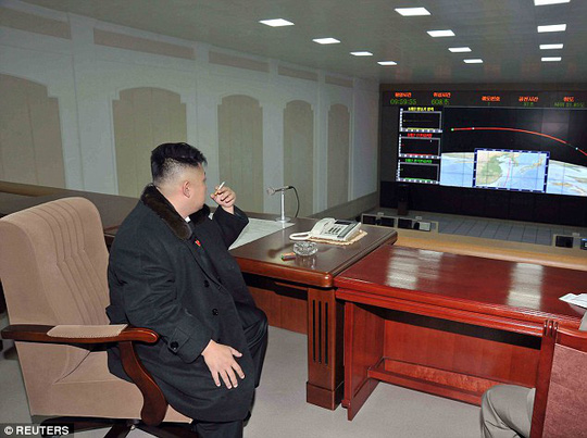 Bond villain pose: North Korean leader Kim Jong-Un smokes a cigarette at the General Satellite Control and Command Center after the launch of the Unha-3 rocket in December
