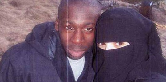 Jihadi couple: Boumeddiene (right)) walked away from a low-paid job as a cashier in 2009 and started wearing a veil. She 'devoted herself' to Coulibaly (left)