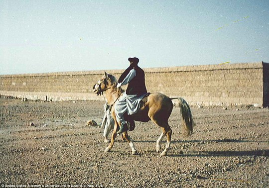 Gallop: The militant is seen riding on a horse below his compound. He escaped Tora Bora on horseback when Western forces were getting closer to his hideout in 2001