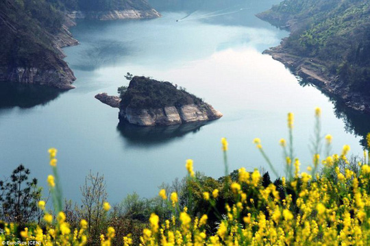 The island seen from afar. Know as the spring turtle rising from water, the rock in Muodaoxi River is a new tourist hot spot in southwest China