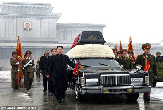 Chilling: Kim Jong-un (centre) marches at the head of the hearse carrying his father Kim Jong-ils coffin in Pyongyang on December 29, 2011