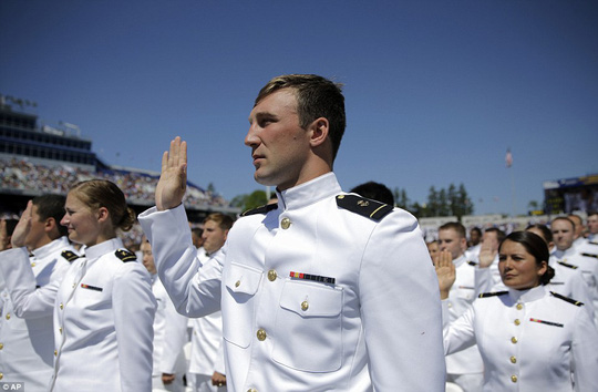Proud: Members of the U.S. Naval Academy raise their right hands as they take an oath of office