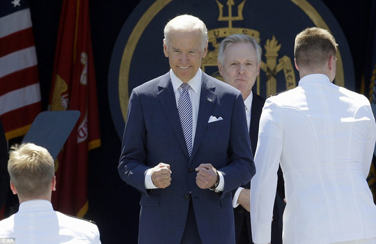 Excitement: Biden, who is pictured gesturing as graduating members head towards him on the stage, told the crowd that many of them will be stationed in the Asia-Pacific region to keep the peace