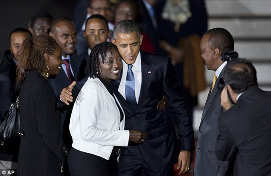 Family reunion:  Obama is pictured above at Bairobis airport hugging Auma, who met him along with the Kenyan president, Uhuru Kenyatta, right in a yellow tie