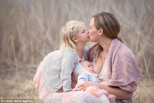 Beautiful: A mother breastfeeds her baby in a wheat field in a photo taken by Tammy Nicole