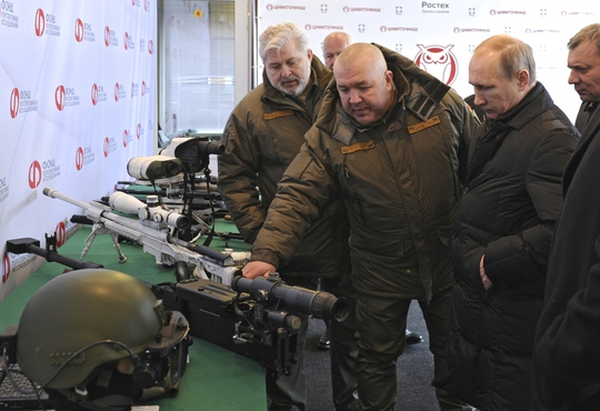 Russian President Vladimir Putin, right front, visits the Central Scientific Research Institute of Precise Mechanical Engineering in Klimovsk, near...