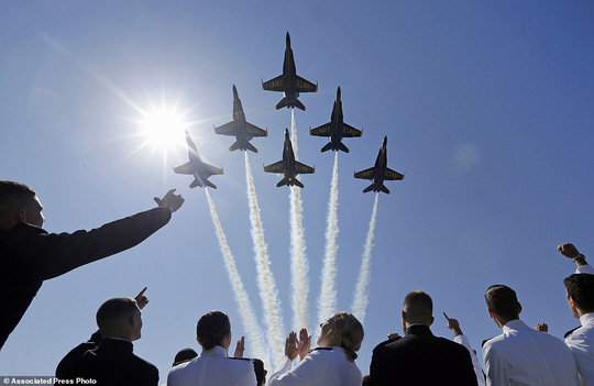 Celebration: The Blue Angels flight demonstration team flies over graduating members of the academy