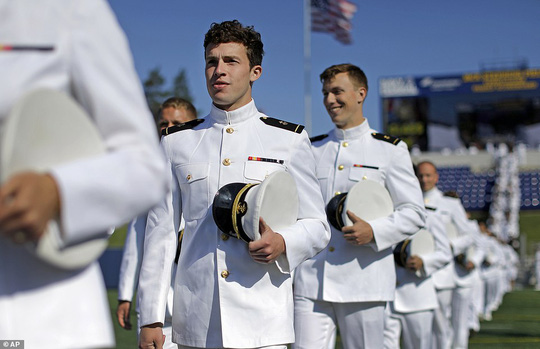 Ceremonious: Graduating members of the U.S. Naval Academy march into the ceremony on Friday morning