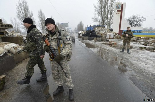 Ukrainian soldiers man a checkpoint at Kostyantynivka, Donetsk region, 22 January