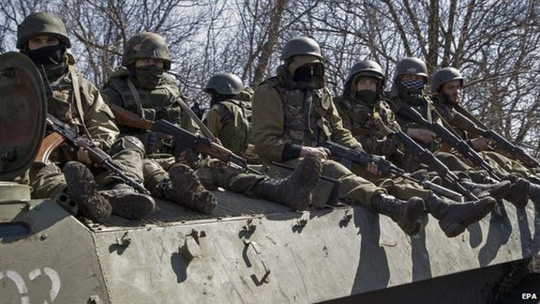 Pro-Russian rebels drive on an armoured military vehicle near city of Donetsk, Ukraine