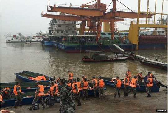 Rescue workers are seen near the site where a ship sank, in the Jianli section of the Yangtze River, Hubei province, China, 2 June 2015