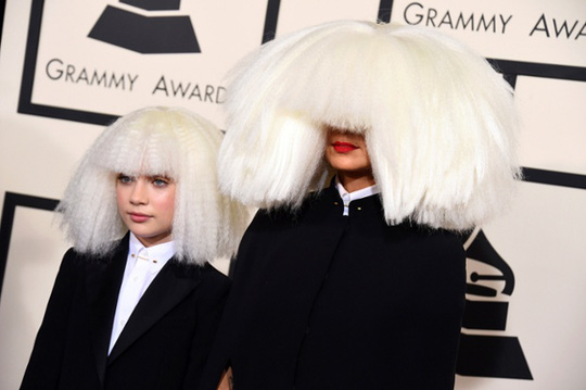 Sia, right, and Maddie Ziegler arrive at the 57th annual Grammy Awards.