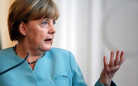 German Chancellor Angela Merkel addresses journalists during press conference in Sarajevo, Bosnia, Thursday, July 9, 2015