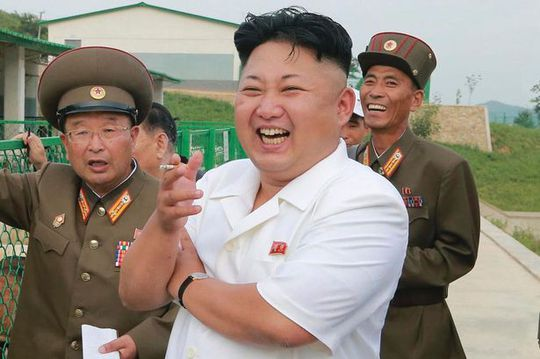 North Korean leader Kim Jong Un laughs