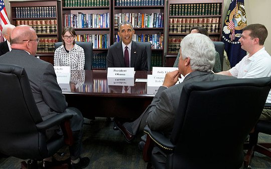President Barack Obama, centre, participates in a roundtable about clean energy with Judy Fisher, clockwise from Obama, Marvin Lance Futch, Rep. Rob Bishop, R-Utah, Harry