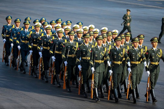 Troops march ahead of President Obama's arrival in Beijing in November.
