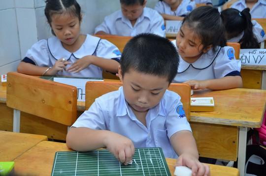 Học sinh một trường tiểu học tại TP HCM Ảnh: TẤN THẠNH
