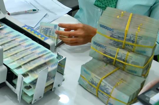 Hàng loạt ngân hàng thương mại đã tăng lãi suất huy động các kỳ hạn thêm 0,2%-0,5%/năm  Ảnh: TẤN THẠNH