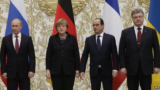 4 nhà lãnh đạo Nga, Đức, Pháp và Ukraine đều tỏ ra căng thẳng. Ảnh: EPA