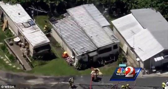 Ngôi nhà phát cháy khi có đến 4 đứa trẻ đang ở bên trong. Ảnh: Wesh