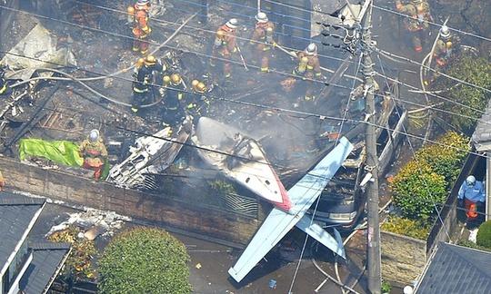 Hiện trường vụ tai nạn máy bay. Ảnh: Kyodo/Reuters