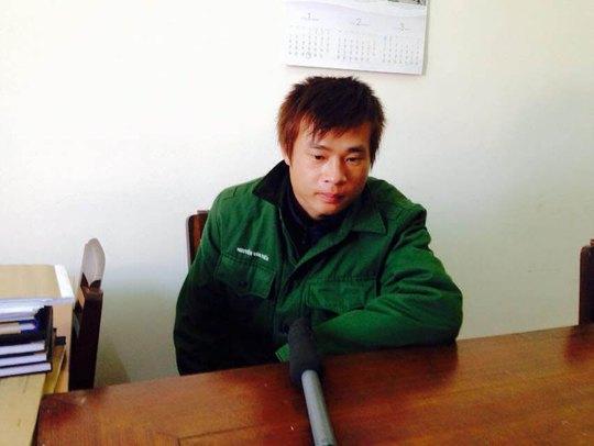 Nghi can Nguyễn Văn Tiến tại cơ quan công an Ảnh: HỮU TRƯỜNG