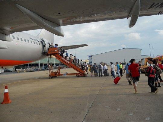 Có nên mở rộng sân bay Tân Sơn Nhất ở TP HCM vẫn là điều đang gây tranh cãi Ảnh: TẤN THẠNH