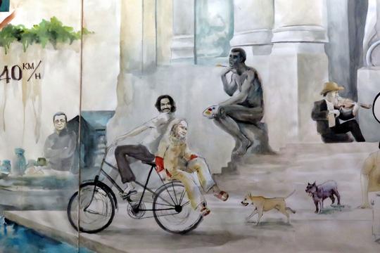 Tranh màu nước vẽ thi sĩ Bùi Giáng ngồi sau xe đạp. (Ảnh tác giả chụp lại)