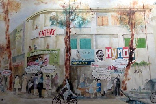 Một bức tranh màu nước ở quán cà phê Người Sài Gòn mô tả cuộc sống đa dạng của thành phố hơn 300 năm tuổi này (Ảnh tác giả chụp lại)