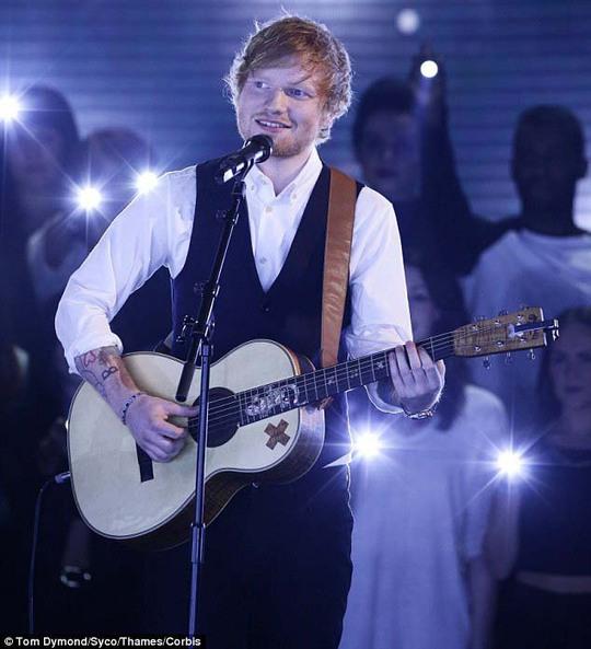 Ca sĩ Ed Sheeran Anh đã được vinh danh ở giải thưởng Album Anh quốc xuất sắc nhất và Nghệ sĩ nam Anh quốc solo xuất sắc nhất tại giải thưởng Brit lần thứ 35-2015 Ảnh: REUTERS