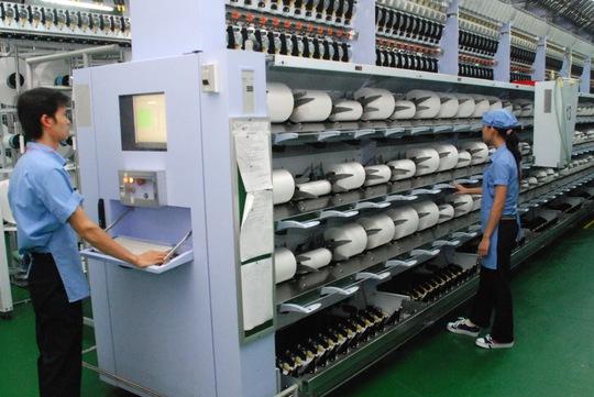 Sản xuất hàng xuất khẩu tại Công ty CP Sợi Thế Kỷ (TP HCM) Ảnh: Tấn Thạnh