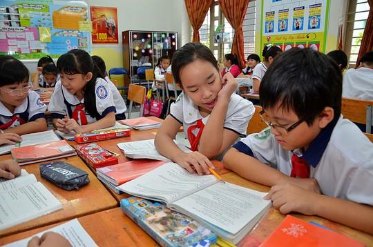 Học sinh lớp 5, Trường Tiểu học Nguyễn Văn Trỗi (TP HCM) trong giờ học văn Ảnh: TẤN THẠNH