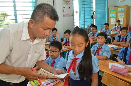 Học sinh lớp 5 của một trường THCS tại TP HCM trong giờ họcẢnh: TẤN THẠNH