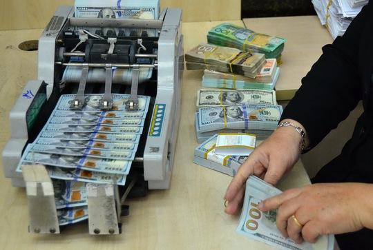 Các ngân hàng không bất ngờ khi tỉ giá được điều chỉnh tăng Ảnh: Tấn Thạnh