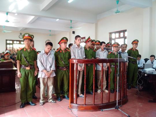 Các bị cáo tại phiên xét xử ngày 13-7