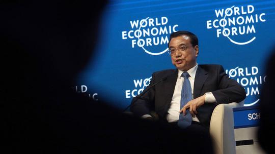 """Thủ tướng Trung Quốc Lý Khắc Cường khẳng định nền kinh tế nước này sẽ không """"hạ cánh nặng nề"""". Ảnh: Bloomberg"""