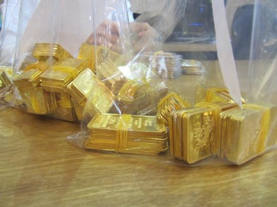 Giá vàng tiếp tục giảm mạnh về sát 36 triệu đồng/lượng - Ảnh 1.