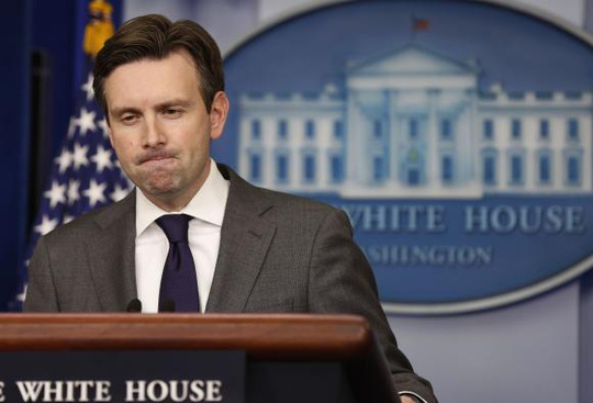 White House Press Secretary Josh Earnest pauses while answering a question about North Korea in the Brady Press Briefing Room at the White House in Washington, December 18, 2014.        REUTERS/Larry Downing