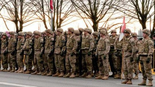 US soldiers await the order to march in the Latvia Day Parade on Nov. 18 in Riga, Latvia.