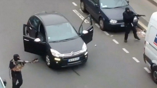 Two gunmen outside the offices of French satirical newspaper Charlie Hebdo in Paris.