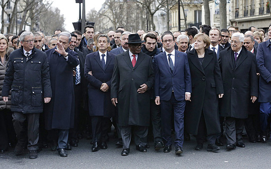 French President Francois Hollande is surrounded by head of states as they attend a solidarity march in the streets of Paris