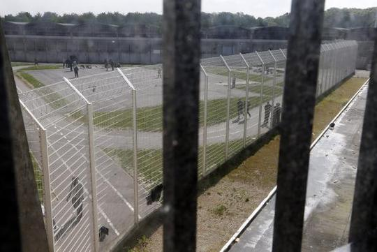 General view of the walking inner courtyard of the mens building inside the Fleury-Merogis prison, near Paris, is seen in this May 14, 2014 file picture.REUTERS-Charles Platiau