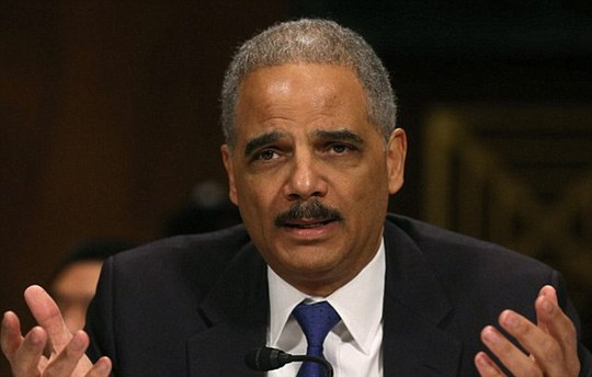 The men conspired to gather economic intelligence on behalf of Russia, including alleged information about U.S. sanctions against the country, and to recruit New York City residents as intelligence sources, U.S. Attorney General Eric Holder (pictured in a file photo) said in a statement