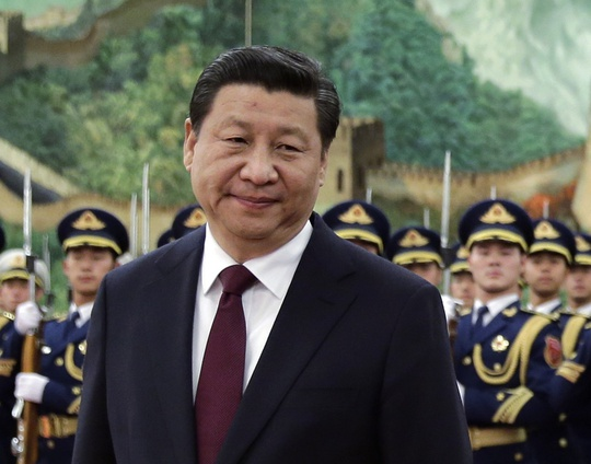 The portrait of Xi as a strongman figure has been painted with excessive haste. (the portrait of Xi as a 'strongman' figure has been painted with excessive haste. (AP Photo/Andy Wong, File)