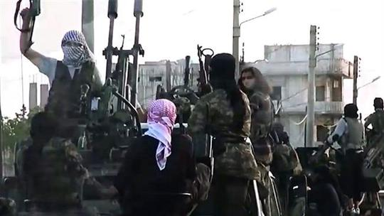This file photo shows ISIL Takfiri militants at an undisclosed location in Syria.