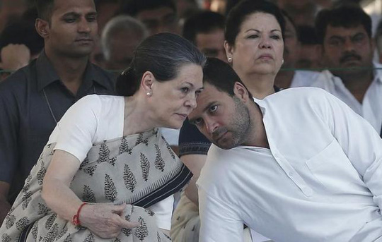 Congress party chief Sonia Gandhi (L) listens to her son and lawmaker Rahul Gandhi (R), at her husband and former Indian Prime Minister Rajiv Gandhis memorial, on the occasion of his 23rd death anniversary, in New Delhi May 21, 2014. REUTERS/Adnan Abidi/Files
