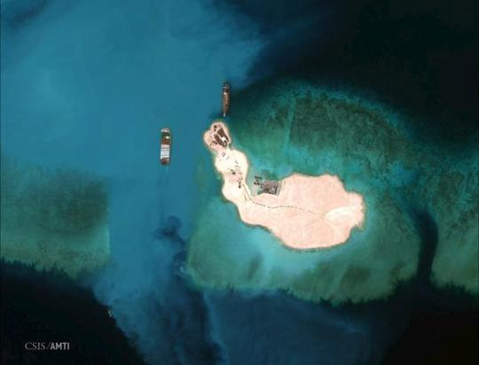 At the southernmost feature, cargo is unloaded onto the shore of Mischief Reef, located 216 km (135 miles) west of the Philippine island of Palawan, in this Center for Strategic and International Studies (CSIS) Asia Maritime Transparency Initiative satellite image taken on March 16, 2015 and released to Reuters on April 9, 2015.REUTERS/CSISs Asia Maritime Transparency Initiative/Digital Globe/Handout