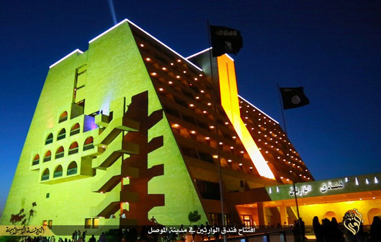 All lit up: The once-renowned, five-star Ninawa International Hotel is located in the extremists northern Iraqi stronghold, Mosul