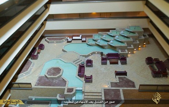 Expensive: One aerial shot reveals how the the hotels main lounge area is dominated by an elaborate water feature that includes a mini-waterfall cut into the marble flooring. The whole scene can be admired from burgundy leather sofas dotted around the atrium