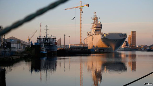 FILE - The Mistral helicopter assault ship Vladivostok, which Russia ordered from France, is seen at Frances Atlantic port of Saint-Nazaire, Sept. 4, 2014.